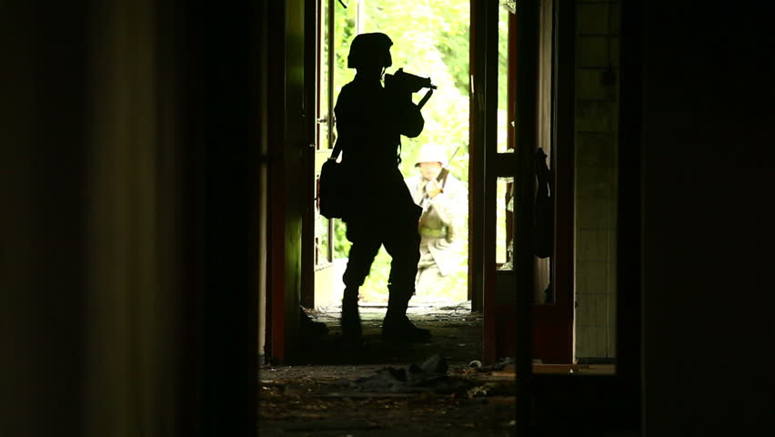 Soldiers running in destroyed building | Shutterstock HD Video #3594224