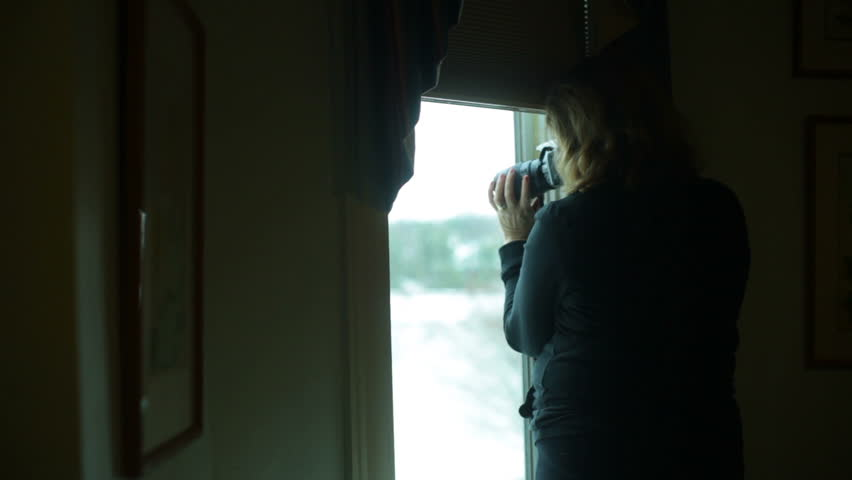 Spying on the neighbors. | Shutterstock HD Video #3598697