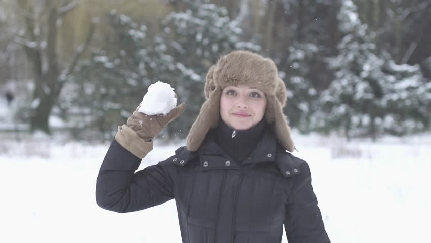 woman throws snowball hitting camera slow motion 1080 HD