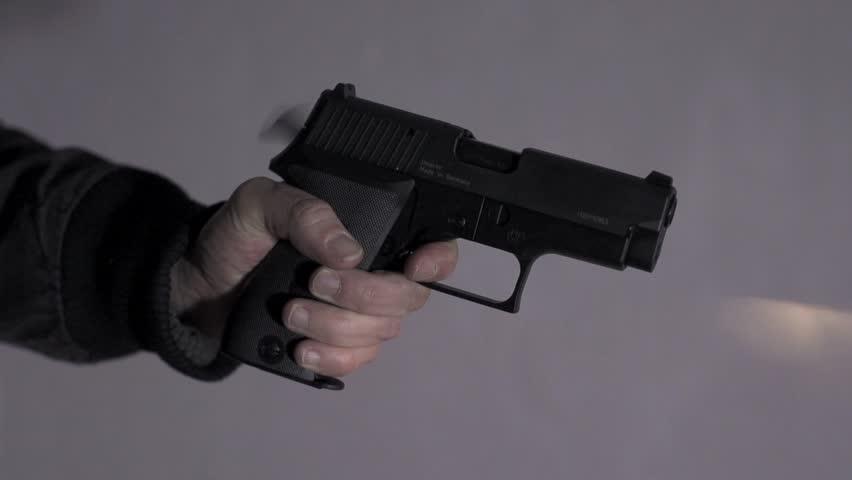 Gun shot in slow motion. guns weapon. police officer using gun weapon. undercover. crime criminal. guns.crime scenery | Shutterstock HD Video #3605813