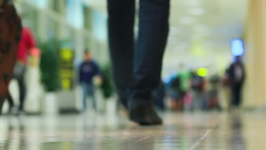 Crowd of people walking with luggage in the international airport, de-focused scene   Shutterstock HD Video #3619388