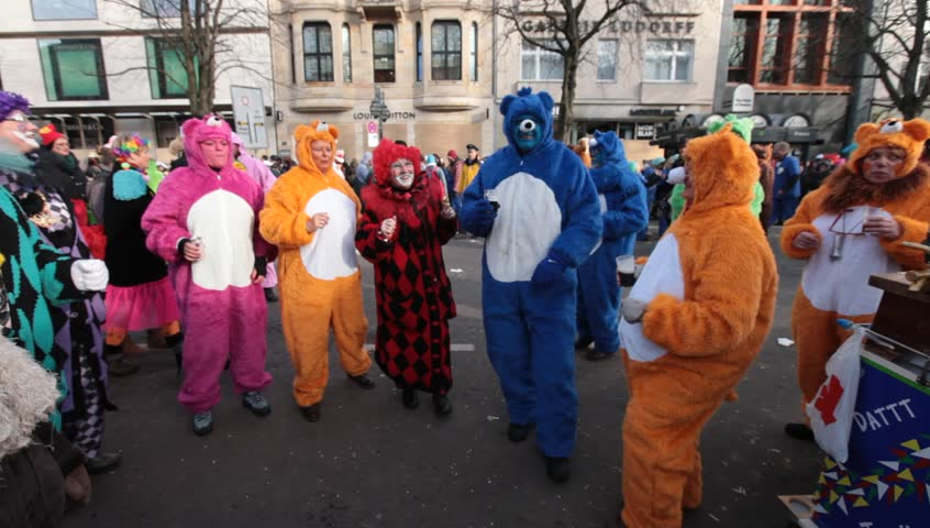 DUSSELDORF, GERMANY – FEBRUARY 10: People present their costumes for the next day celebration of Rosenmontag Karneval or Carnival. February 10, 2013,  Düsseldorf, Germany