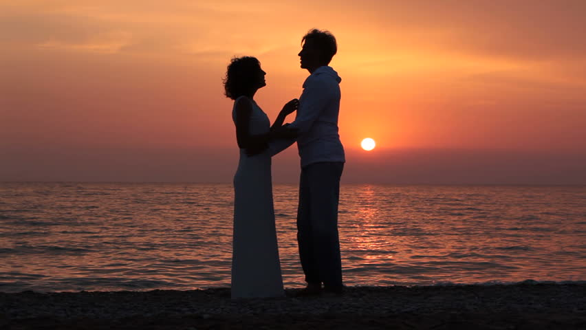 Vector silhouette of couple dancing latin with orange sun