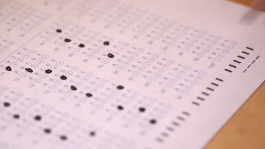 A close-up look at filling in the little circles of a test paper.