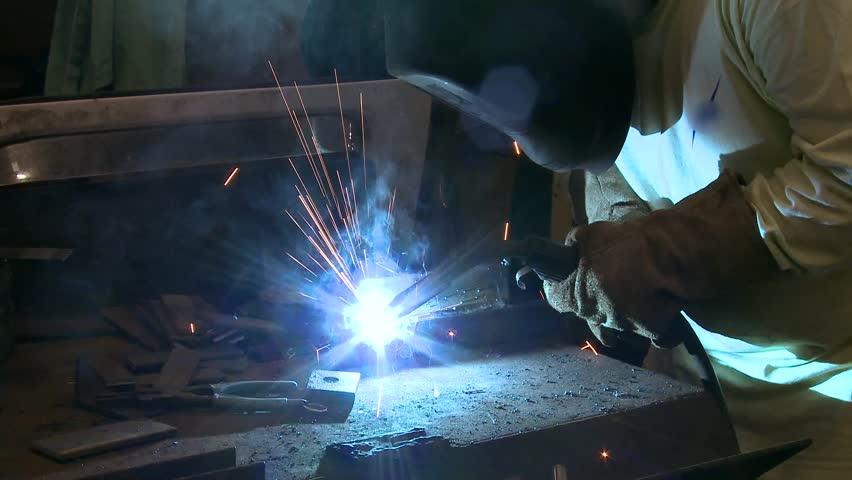 Bright arc of a welder working on a job   Shutterstock HD Video #3662753