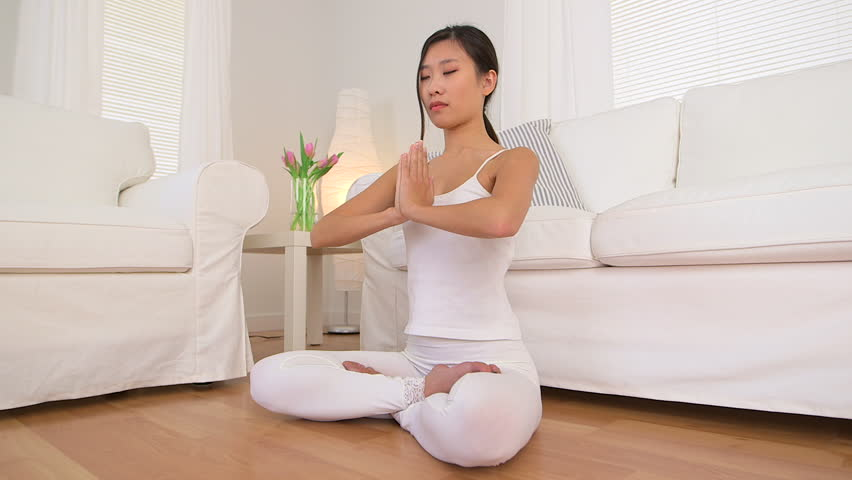 Asian Woman Doing Meditation Stock Footage Video (100% Royalty-free)  3668057 | Shutterstock