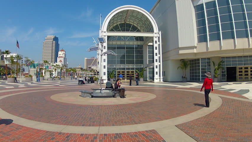 LONG BEACH, CA - APRIL 2, 2013: The Long Beach Convention Center with people milling on the entrance plaza circa 2013 in Long Beach. Long Beach is a major destination for conventions and tourists.