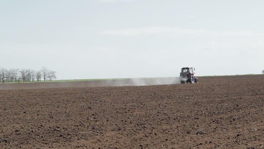 Farm tractor spraying field before planting | Shutterstock HD Video #3682589