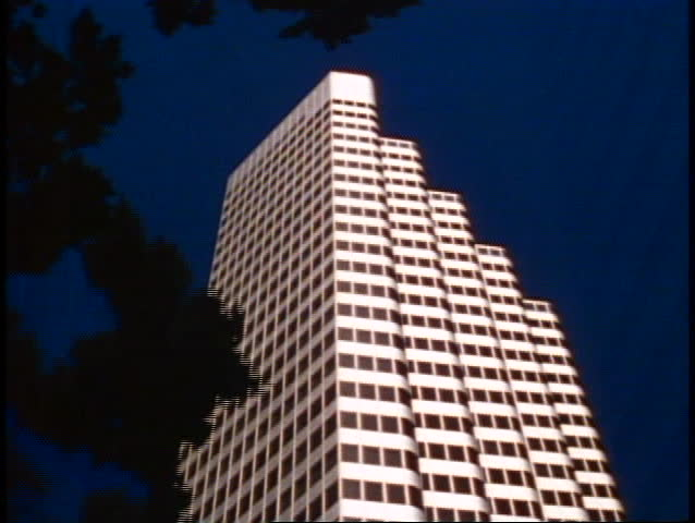 San Francisco, 1970's, modern skyscraper, no people, top only, framed in trees