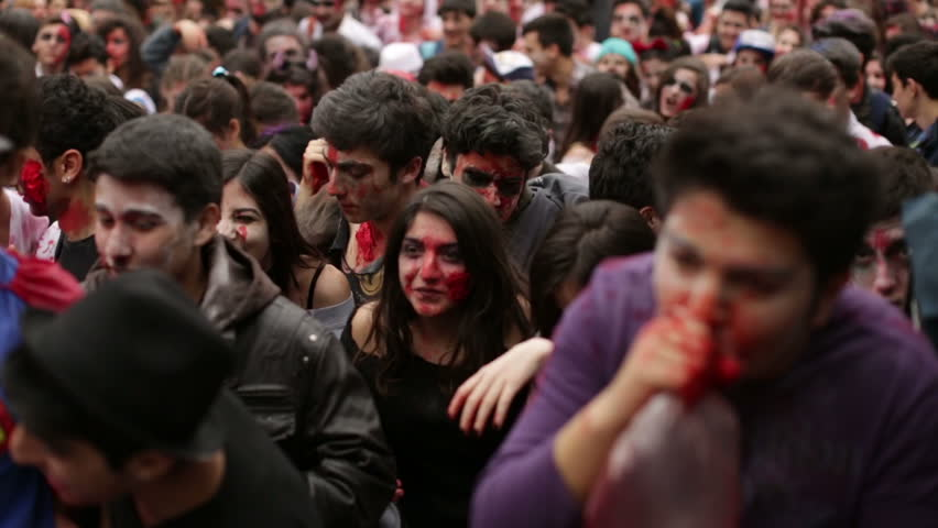 ISTANBUL - APRIL 7: People dressed as zombies walking on the street during Zombie Walking Dead event in Istanbul, Turkey on April 7, 2013.