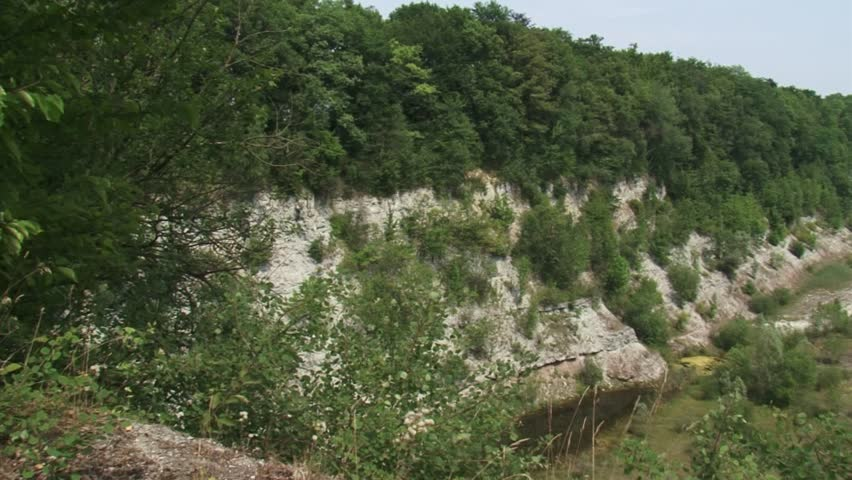 Abandoned limestone quarry, overgrown with trees and shrubs. Nowadays, the eastern pit is a nature reserve. Ratum quarry, The Netherlands.