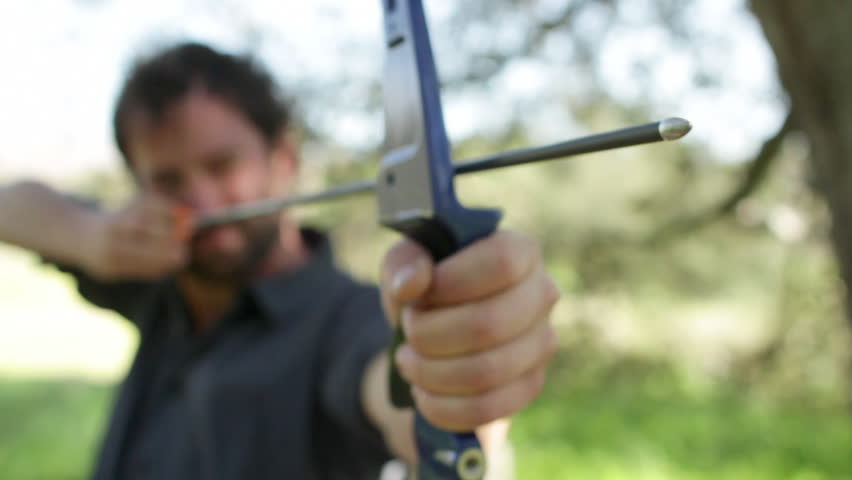 Archer viewed from the front with focus on the arrow tip. Clip doesn't change focus.