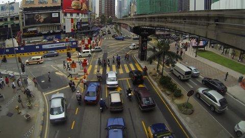 KUALA LUMPUR - MARCH 21:  panning time lapse of  traffic on Jalan Bukit Bintang in Kuala Lumpur Malaysia on 21 March 2013