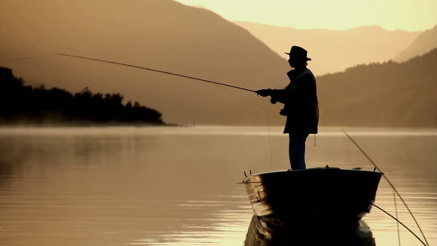 fly fisherman fishing from boat, silhouette