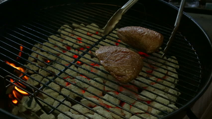 Flipping sirloin steak