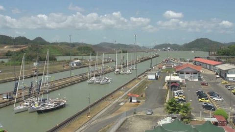 Sailboats waiting for gate to close in Panama Canal