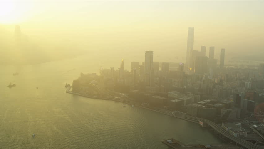 Aerial sunset view over Kowloon with Victoria Harbour | Shutterstock HD Video #3740564