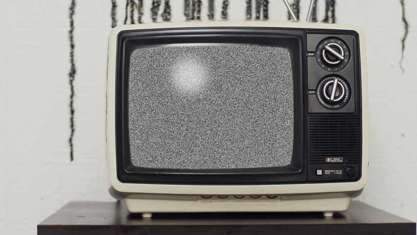 Retro TV in front of grungy wall (close up version) | Shutterstock HD Video #3748916