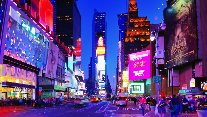 NEW YORK CITY - APRIL 9: Times Square April 9, 2013 in New York, NY. Times Square is one of the most visited landmarks in the world with over 39 million visitors annually. | Shutterstock HD Video #3755390