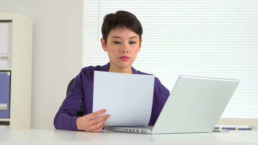 Chinese Businesswoman Reading Papers at Stock Footage Video (100 ...
