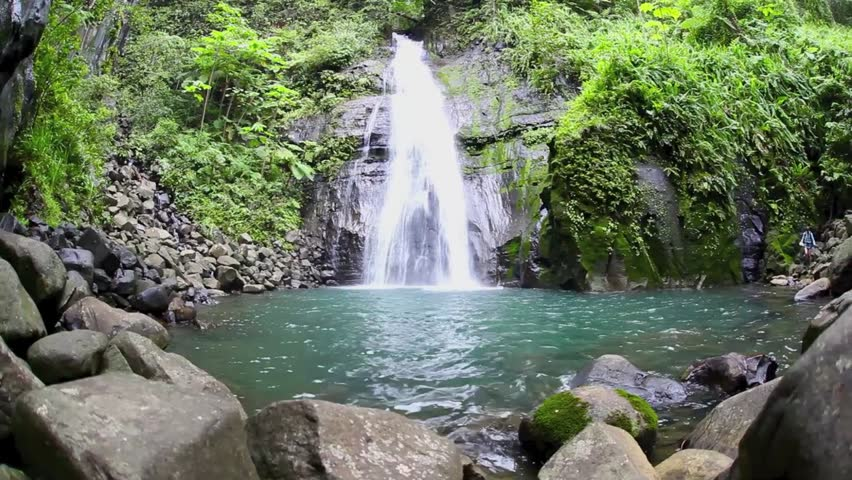 A gorgeous waterfall drops into a natural pool on Cocos Island, Costa Rica.  This island is a national park known for its scuba diving and receives plenty of rain annually.