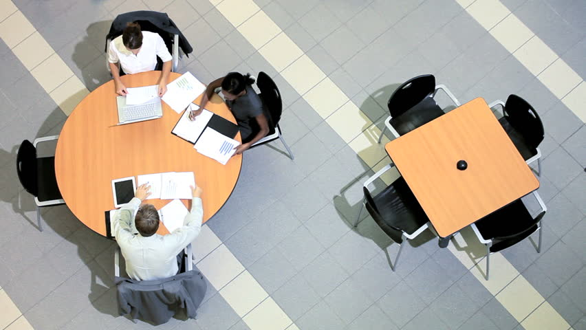 Overhead view of multi ethnic business groups with clients holding meetings to future plan projects | Shutterstock HD Video #3770975