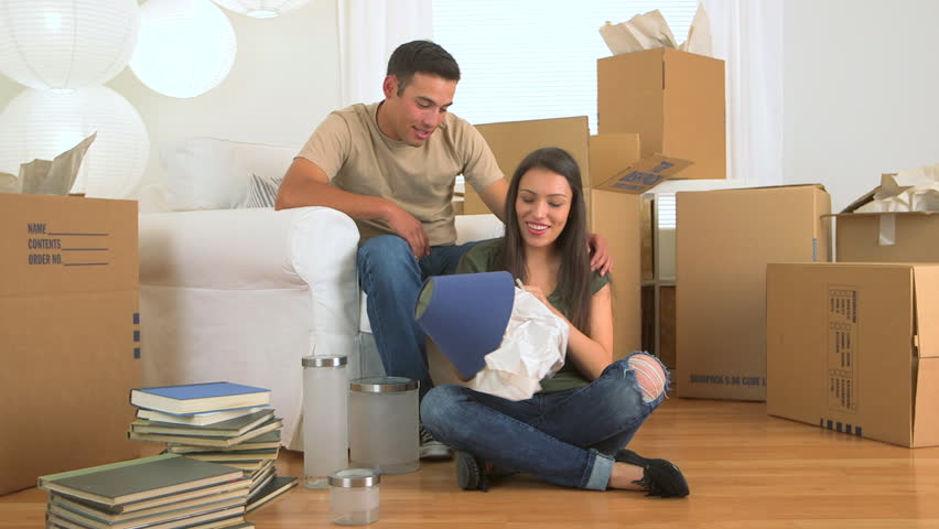 Mexican couple unpacking lamp #3773969