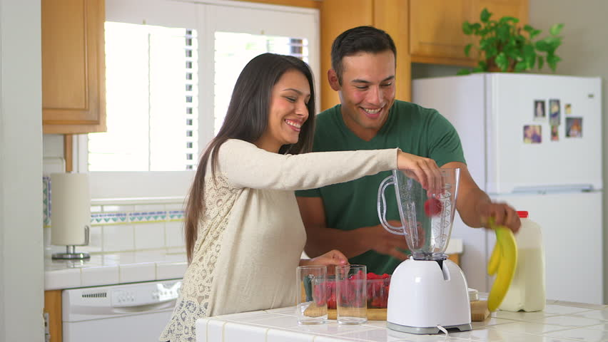 Mexican couple making smoothies