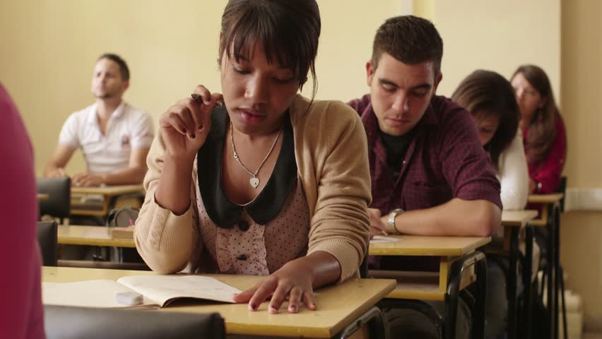 Women and men at school, group of young students during test in college class Royalty-Free Stock Footage #3776210