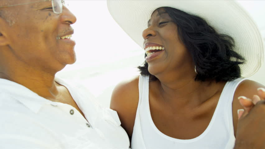 Elderly African American couple laughing dancing on beach close up shot on RED EPIC