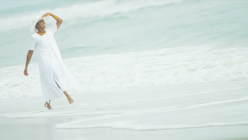 Elegant senior African American female enjoying the peace by the ocean shot on RED EPIC | Shutterstock HD Video #3780191