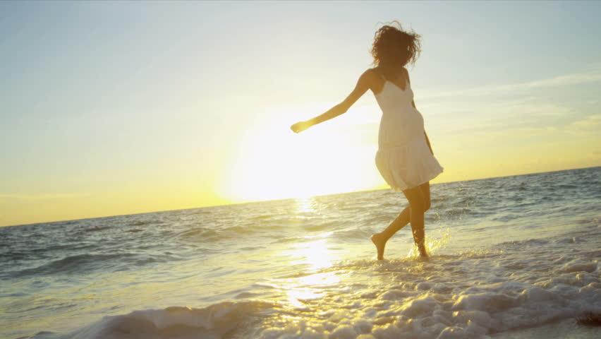 Beautiful Hispanic girl white sundress ocean shallows sandy beach sunset shot on RED EPIC | Shutterstock HD Video #3789731
