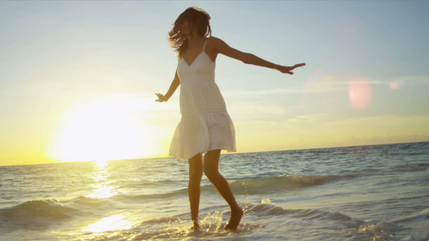 Pretty girl in sundress reveling being alone by ocean at sunrise on beach vacation shot on RED EPIC | Shutterstock HD Video #3789734