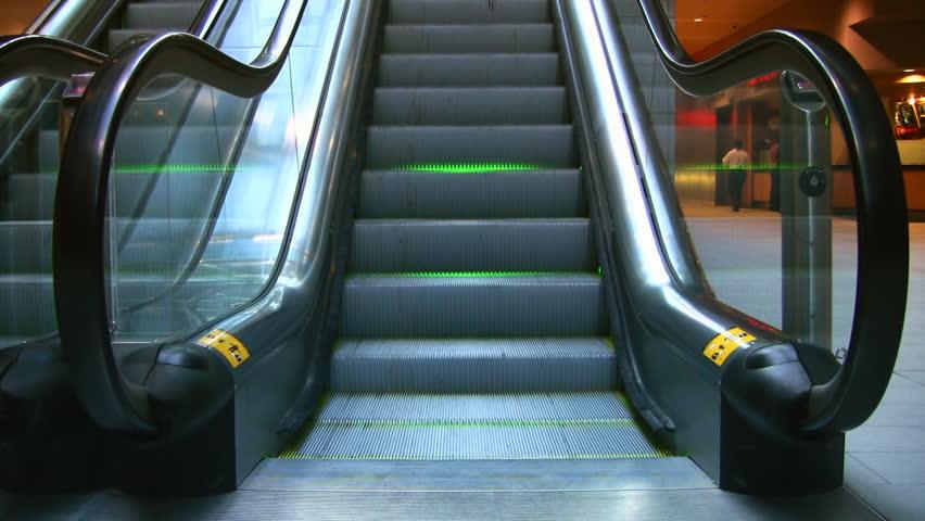 An Escalator With Neon Green Lighting