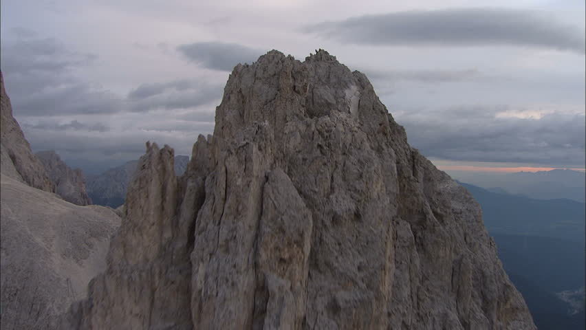 Flight over Mountains Peaks, Sunset, Flight above forest an mountains, Cineflex aerial, fly over rocks,