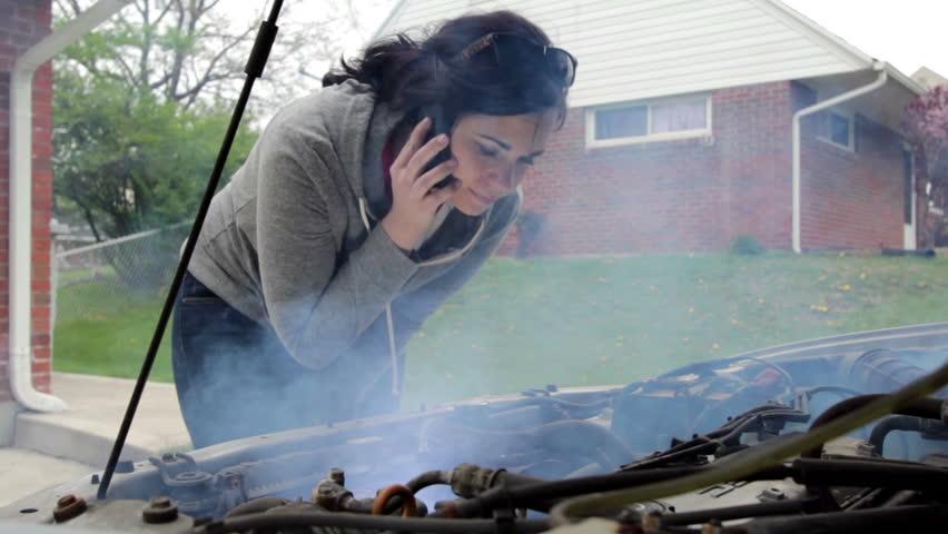 Female with broken down smoking car