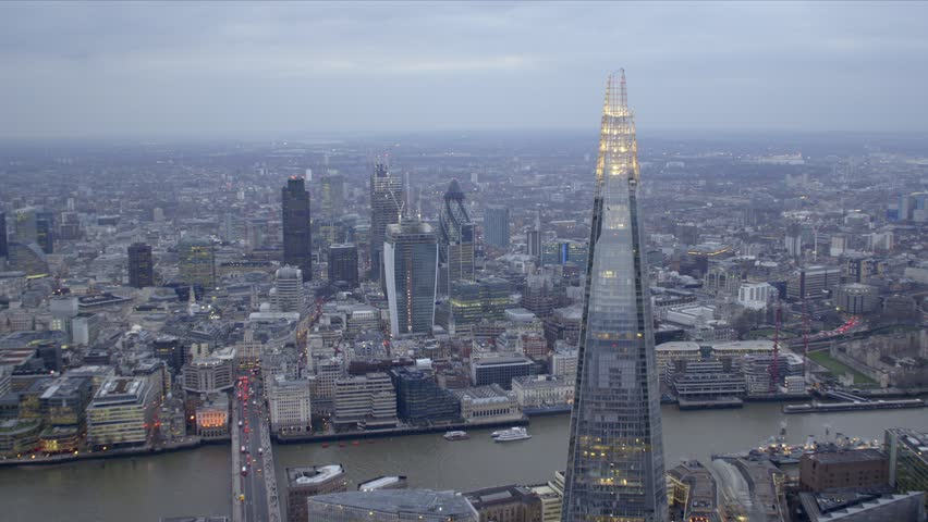 Dramatic aerial shot of the central London skyline featuring The Shard building, River Thames & City of London financial district. | Shutterstock HD Video #3818060