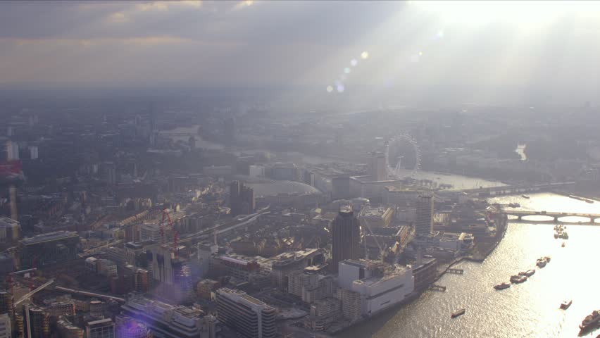 Panoramic aerial shot of central London along the Thames as dusk