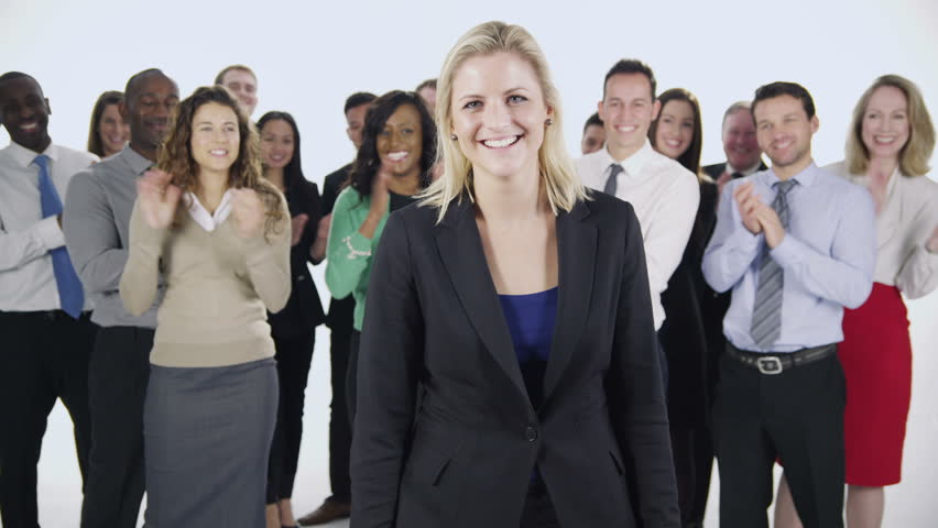 Portrait of a group of happy and diverse business people who are standing together, isolated on white. One woman stands at the front and the rest of her team stand behind her, applauding her success.  | Shutterstock HD Video #3818480