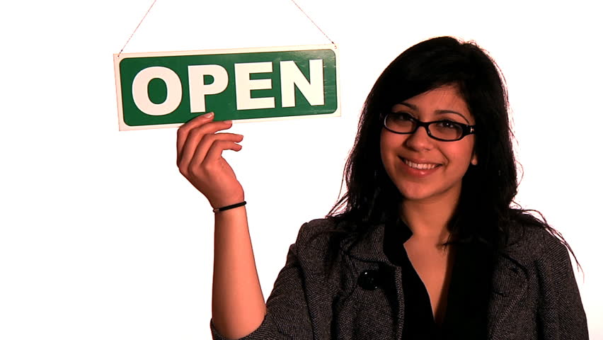 Open for business - a young hispanic woman turns a sign from Closed to Open | Shutterstock HD Video #3843995