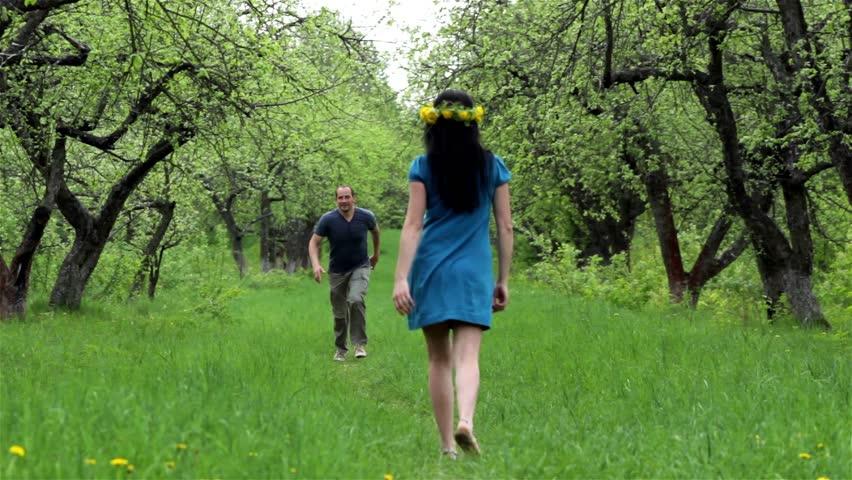 Boy and girl in the garden running towards each other  | Shutterstock HD Video #3844694