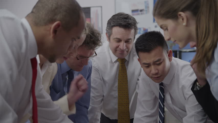 Diverse team of professionals, brainstorming in a business meeting under the watchful eye of their boss. He is evaluating his employees and taking pride in their expertise. In slow motion. | Shutterstock HD Video #3849377