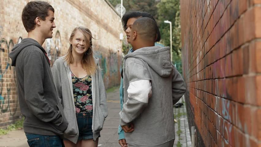Urban Teens - a multi-racial group of urban teenagers in an alleyway