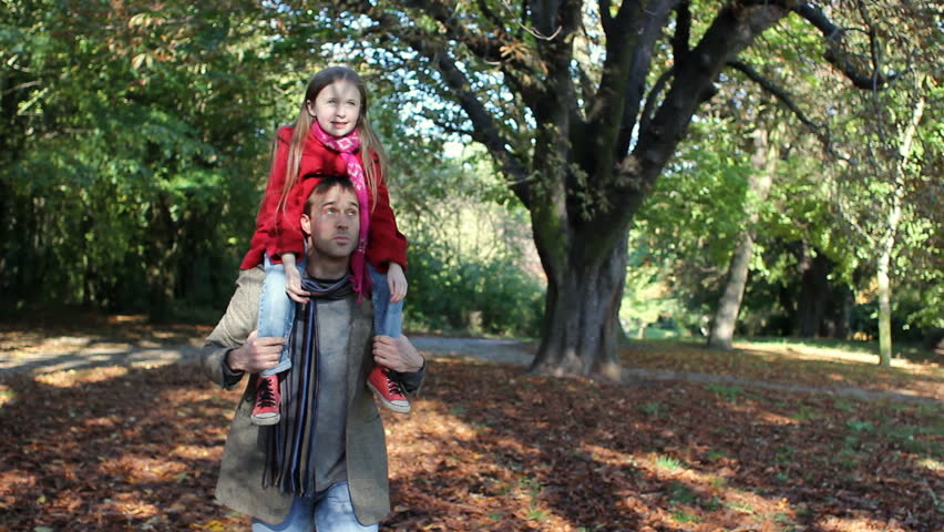 Father and daughter - playing in the autumn leaves | Shutterstock HD Video #3850721