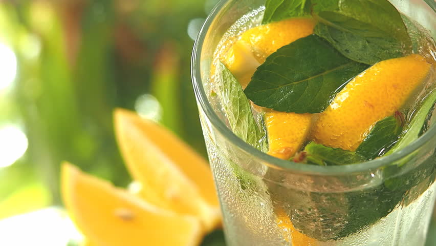 a glass with lemon, mint and ice cubes #3852101