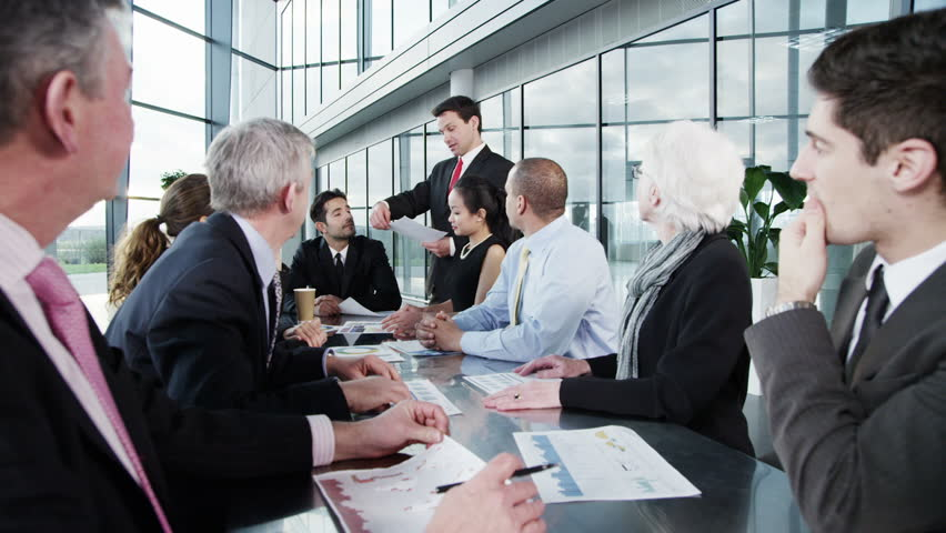 A confident and attractive business team of mixed ages and ethnicity are holding a meeting in a light, modern office building. They are discussing ideas for their business development.    Shutterstock HD Video #3857969