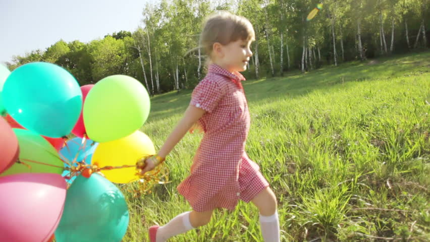 Young Woman Playing with Balloons Stock Footage Video (100