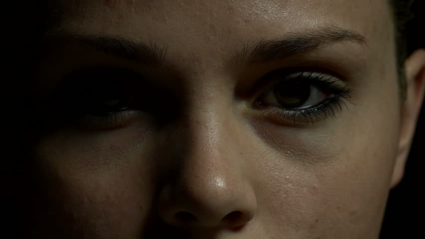 Close up of woman's eyes in color. Experimental lighting.