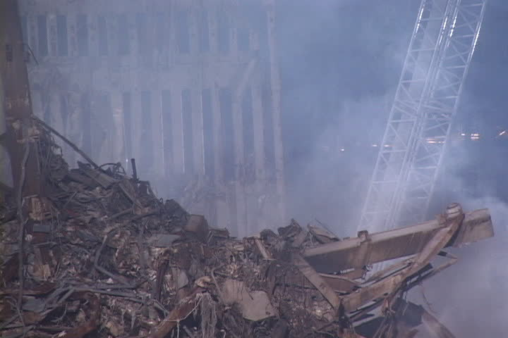 NEW YORK CITY - SEPTEMBER 28, 2001: Smoke rising from rubble pile with remains of World Trade Center structure in background.