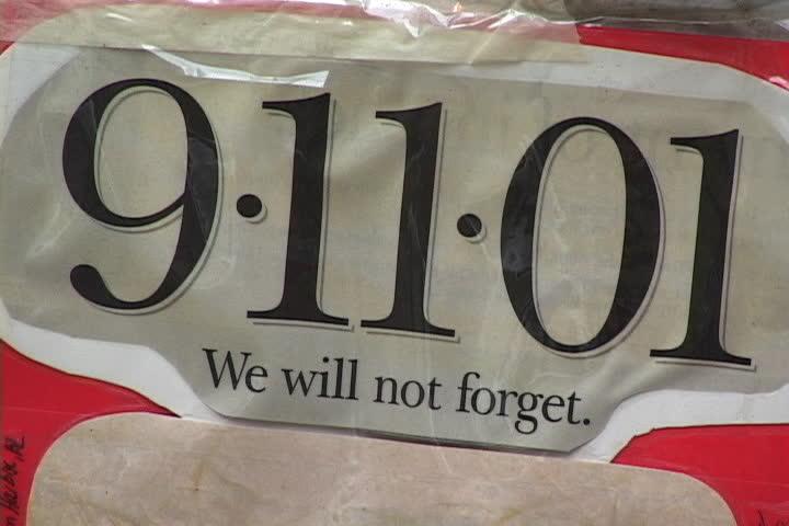 NEW YORK CITY - SEPTEMBER 29, 2001: We Will Not Forget headline left at 9/11 memorial outside Engine 23 fire station.